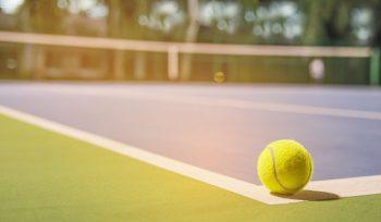 Tennis ball at the hard court corner line
